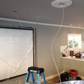 Installing recessed lights.